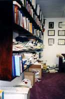 Disorganized bookcase in library